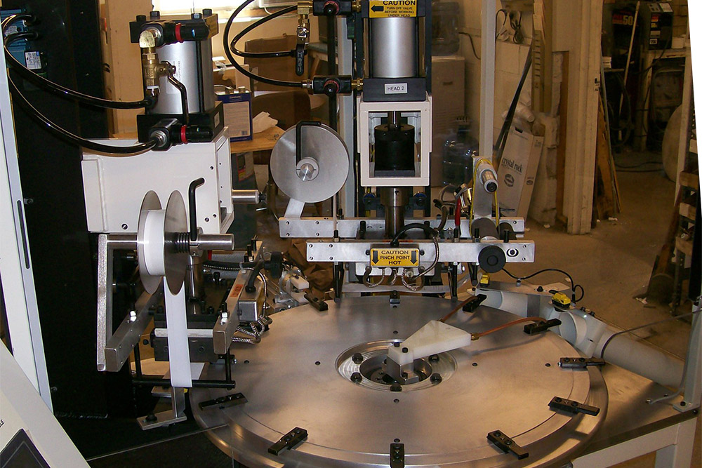 Model VT-10 0.5 ton hot stamping machines mounted around a 12 station indexing table
